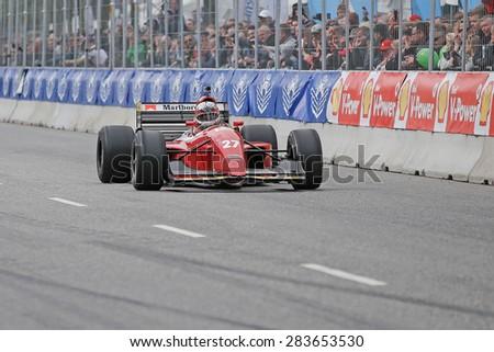 AARHUS, DENMARK - MAY 23 2015: Claus Bertelsen in a Ferrari model Jean Alesi formula one racing car from 1992, at the Classic Race Aarhus 2015