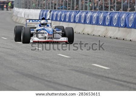 AARHUS, DENMARK - MAY 23 2015: Eddie McLurg in al Arrows A18 formula one racing car from 1997 at the Classic Race Aarhus 2015