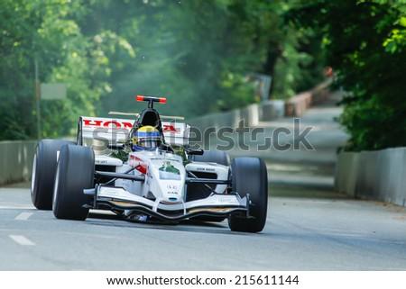 AARHUS, DENMARK - MAY 17 2014: Johan Rajamaki in a BAR/HONDA formula one racing car at the Classic Race Aarhus 2014