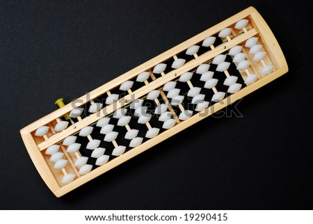 Abacus on black background