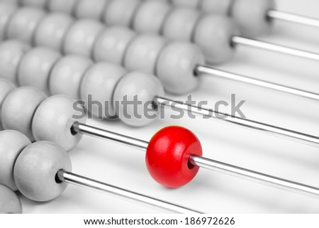 Abacus red bead closeup. Leadership concept. Stock photo ©