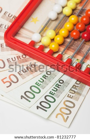 Abacus toy calculator and euro, european money banknotes