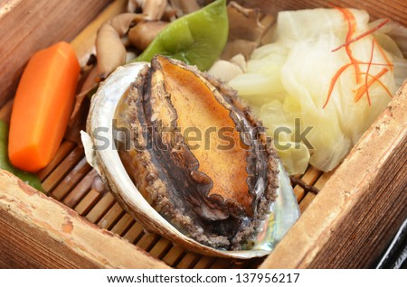 Abalone with vegetable on the dinner table