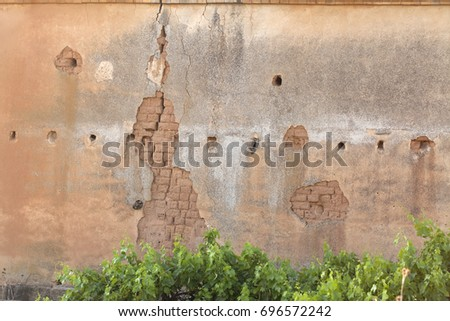 abandoned adobe house with...
