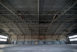 Abandoned airplane hangar with large trusses