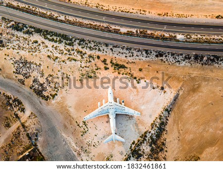 Abandoned airplane in the in the Umm Al Quwain desert in the emirate of the United Arab Emirates aerial view at sunrise stock photo