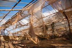 Abandoned and broken greenhouse in the countryside of Tenerife in Spain