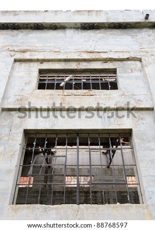 abandoned and broken power house walls and windows