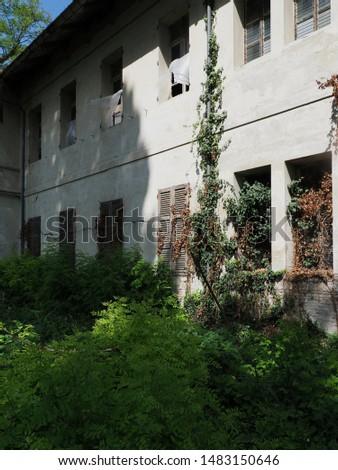 Abandoned and damaged building. Damaged windows, ghostly atmosphere.