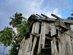 abandoned and dilapidated view of old wooden house. broken and old view from past life