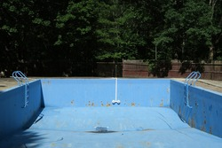 Abandoned and neglected outdoor pool.