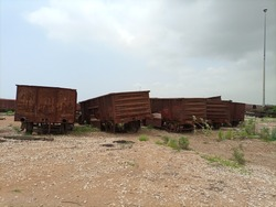 Abandoned and out of service train  wagons in a  railway yard  on ground. These wagons are waited to be cut down.