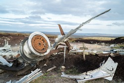 Abandoned B29 WW2 American AS Airforce Bomber Overexposed crash site on Bleaklow Moor with rusty aircraft engine parts and aeroplane landing gear wheels wreckage strewn across Peak District landscape