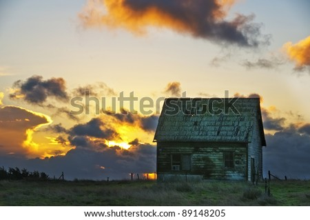 abandoned barn in the sunset