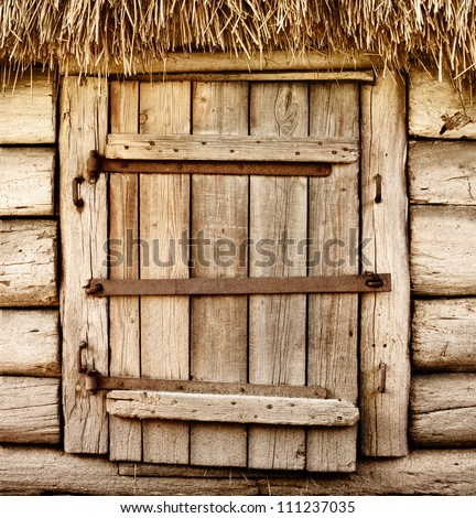 Abandoned barn vintage wooden door. Old photo of rustic house entrance