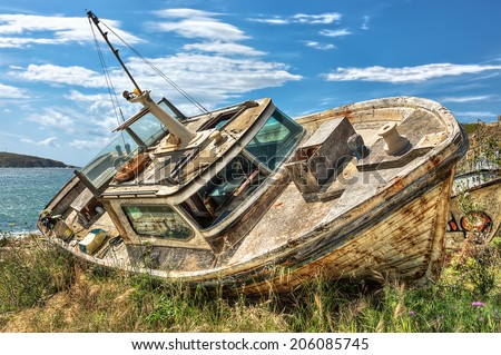 Abandoned beached boat in Mykonos, Cyclades, Greece, HDR
