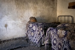 Abandoned bedroom of a house with old forgotten beds. Abandoned places