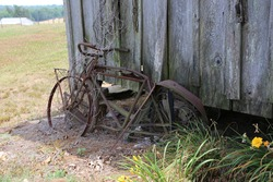 Abandoned bicycle at old building.