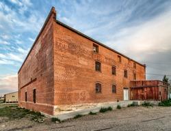 Abandoned Brick Building, Broken Windows