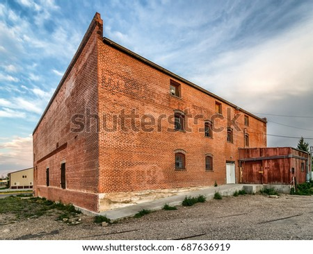 Abandoned Brick Building, Broken Windows