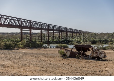 abandoned bridge with abandoned car in the foreground in the Australian Outback