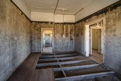 Abandoned building in the ghost town of Kolmanskop near Luderitz, Namib Desert, Namibia.