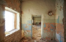 Abandoned building with door and window frame. The gloomy place was empty and dilapidated