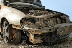 Abandoned burnt down car after an explosion, ready to be scrapped