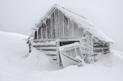 abandoned cabin in snow after snow storm