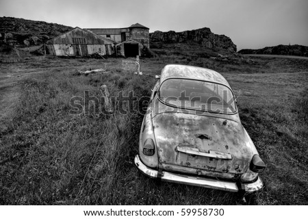 Abandoned car and farm in black and white, end of the word concept. Location, Iceland.