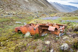Abandoned car in a remote place in the mountains