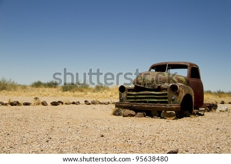 Abandoned car on a road in Namibia