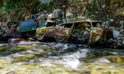 Abandoned cars in a creek