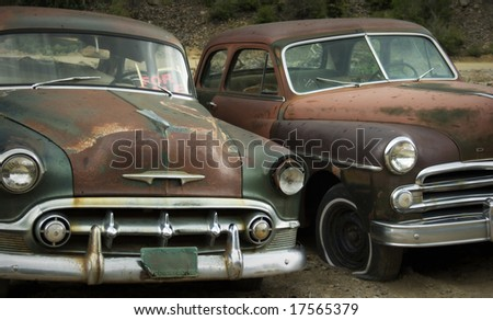 "Abandoned cars in junkyard. ""For Sale"""