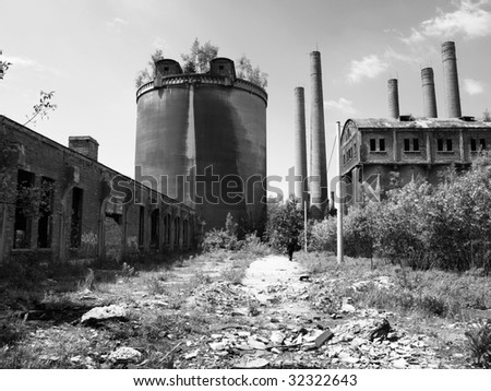 Abandoned cement plant in Poland. - stock photo