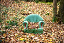 Abandoned chair in autumn forest