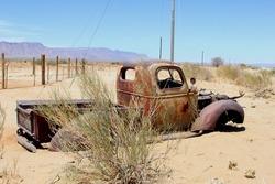 Abandoned classic pickup car stuck in sand, Kalahari desert, NAMIBIA AFRICA