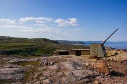 Abandoned coastal artillery battery. Landscapes of the Murmansk region, Teriberka, Russia.