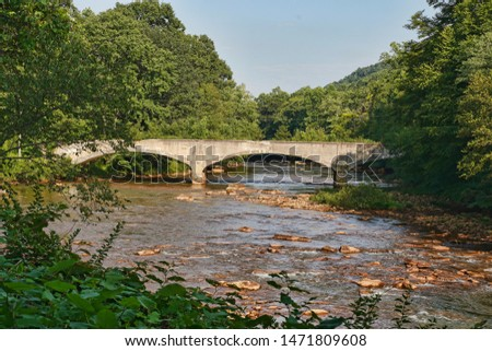 Abandoned, concrete, arch bridge along the Ghost Town Trail in Western Pennsylvania. Scenic background image.  Rails to trails. Allegheny trails.