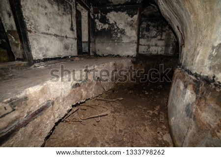 abandoned corridors of post soviet rocket launch base in latvia after fire with black walls and metal details #1333798262