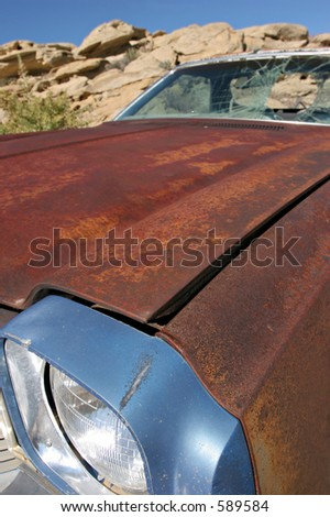 abandoned el camino, rusting away and with broken windshield in rural wyoming. wide angle closeup with focus on front - limited depth of field