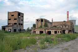Abandoned factory - concrete ruins in industrial district