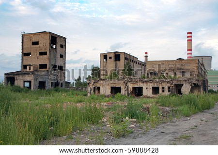 Abandoned factory - concrete ruins in industrial district - stock photo