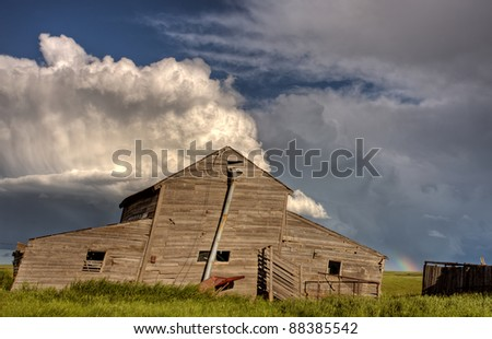 Abandoned Farm Buildings Saskatchewan Canada Storm clouds Prairie