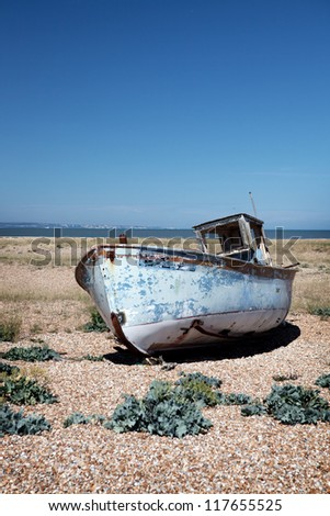 abandoned fishing trawler on beach. old ship wreck on english south coast in dungeness