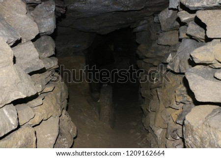 abandoned galleries mining and processing of natural stone in  cave. caves and dark stone tunnels in  rock. galleries and corridors of cavernous catacombs.