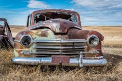 Abandoned green car on the prairies in Saskatchewan