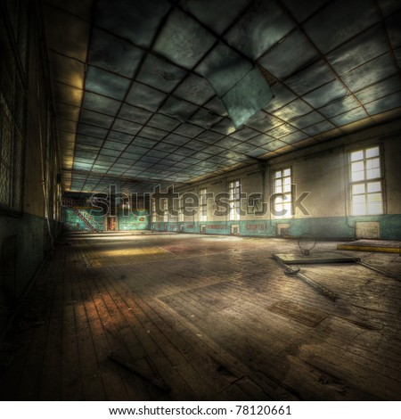 abandoned gym with cyrillic letters on the walls, hdr processing