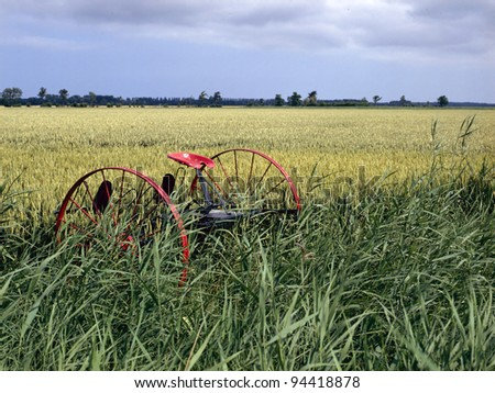 abandoned historical agricultural machinery in a field