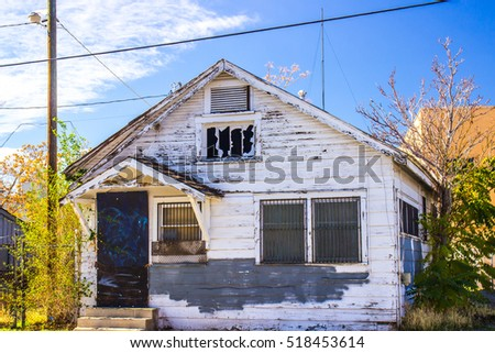 Abandoned Home In Disrepair With Barred Windows